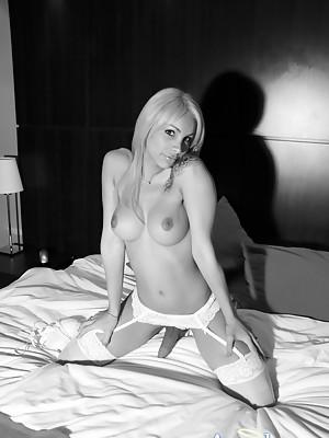 TS Angeles Cid in white lingerie lets her gargantuan she-cock hang limp